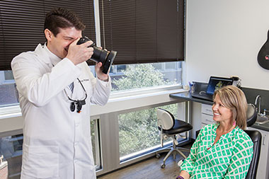 Doctor taking photo of patient's smile